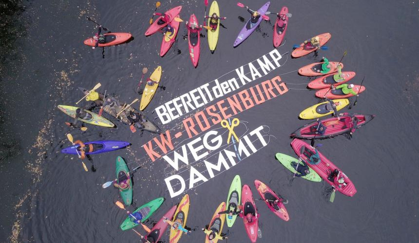 "Protest action at the dam Rosenburg on the Kamp river in Lower Austria. The floating letters say ""Free our rivers. HPP Rosenburg – Get rid of it"" © Riverwatch"