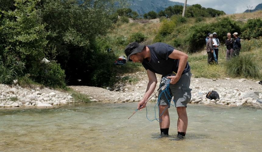 Professor Gabriel Singer (University of Innsbruck) at the Shushica river taking water samples for providing further evidence that the river network of the Vjosa catchment needs the best protection possible. © Nick St.Oegger