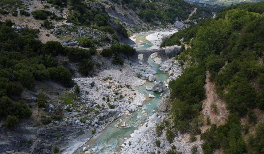The Shushica river with the famous Ottoman bridge at Brataj. Just upstream of this spot a dam is planned. © Nick St.Oegger