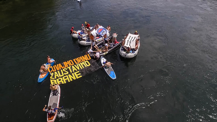 "For the first time, environmental groups and angling associations used the Drina Regatta to protest against the dam plans. The slogan ""Čuvajmo Drinu, zaustavimo brane!"" (""Save the Drina, stop the dams"") was floating down the river. © Dušan Mićić"